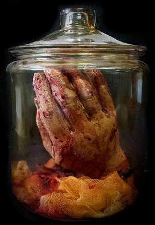 Male Severed Hand in Jar